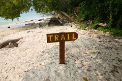 Trail sign on the beach of Palau Mamutik Royalty Free Stock Images
