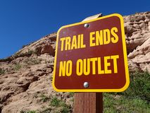 Trail sign close up in canyon. Brown and yellow trail ends no outlet sign, Red Rock Canyon, Whiting Ranch Wilderness Park, Mission Viejo, California, hiking Stock Photo