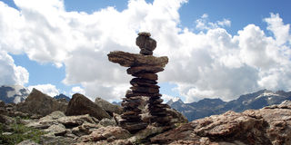 Trail Sign. Man like stone pyramid. Caucasus Mountains vintage effect. Royalty Free Stock Images