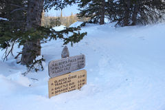 A trail sign is nearly buried by the snow. Stock Image