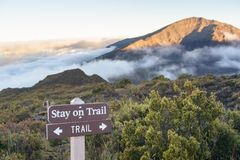 Trail in mountains above the clouds at sunset or sunrise Stock Images