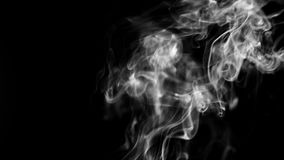 Trail of Smoke Coming Up from Bottom of Screen. 4k Trail of smoke coming up from the bottom of the screen, on a black background. Use the composite mode Screen stock video footage