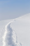 Trail in the snow in the mountains Royalty Free Stock Photo