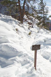 Trail through snow on Scouts Lookout on Angels Landing Hiking Trail in Zion National Park in Utah Stock Photo