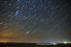 Trail stars around Polar Star  glowing over city. Stock Photography