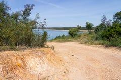 Trail to Albufeira da Barragem de Campilhas lake Stock Image