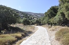 Trail to Cave of Zeus in Dikti mountains from Crete island of Greece. Picturesque Trail to Cave of Zeus in Dikti mountains from Crete island of Greece on August royalty free stock images