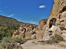 Trail to Ruins in Bandelier National Monument. A trail winds through Frijoles Canyon to Native American ruins in Bandelier National Monument Royalty Free Stock Image