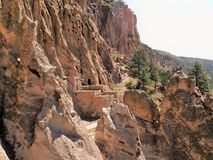 Trail to Ruins in Bandelier National Monument. A trail winds through Frijoles Canyon to Native American ruins in Bandelier National Monument.  Los Alamos, New Stock Photography