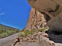 Trail to Ruins in Bandelier National Monument. A trail winds through Frijoles Canyon to Native American ruins in Bandelier National Monument.  Los Alamos, New Stock Image