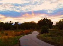 The trail to sunset. On a walk as the sun slowly fades into night Royalty Free Stock Photos