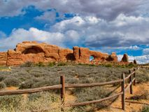 Trail to the Windows at Arches NP. Arches National Park in Utah offers spectacular views of mountains and rock formations.  Beautiful in Winter.  Near Moab Royalty Free Stock Photo