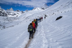 Trail trekking in the Himalayas between Dingboche and Dughla Stock Photos