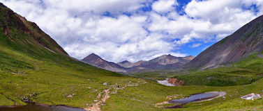 The trail in the valley trough. Eastern Sayan. Stock Photography
