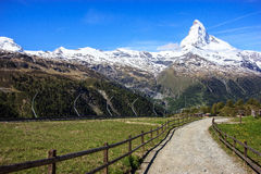 Trail with view of Matterhorn Peak in summer at Sunnega station, Rothorn Paradise, Zermatt, Switzerland.  Stock Photography