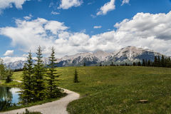 Trail walking in the rocky mountains Stock Photos