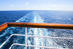 Trail on water surface behind of cruise ship. Royalty Free Stock Images