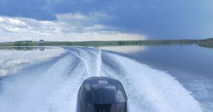 Trail on water surface behind of fast moving motor boat. the motor of motor boat, back view. Sea water ship trail with. White foamy wave. Tropical islands ferry stock footage