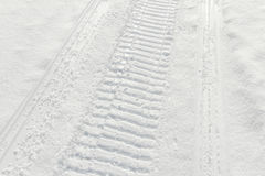 Trail of wheel in fresh snow Royalty Free Stock Images