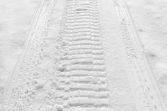 Trail of wheel in fresh snow Royalty Free Stock Photo