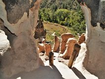 Trail to Ruins in Bandelier National Monument. A trail winds through Frijoles Canyon to Native American ruins in Bandelier National Monument.  Looking out of a Stock Photos