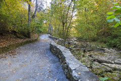 Trail in the Woods. Cedar Creek Trail at Natural Bridge in the fall, brick and stones line the trail and creek royalty free stock images