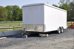 Trailer. Large white trailer used for hauling and transporting stock photography