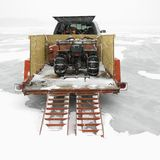 Trailer with ATV. Trailer with ATV parked on frozen lake in Green Lake, Minnesota, USA Royalty Free Stock Images
