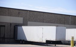 Loading Hub at a Distribution Center. A trailer being loaded with commercial and retail goods at a distribution depot and distributing center stock image