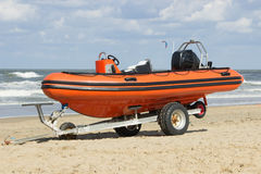 Trailer with boat for emergency services on the beach Royalty Free Stock Photography