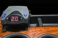 Trailer brake mounted on dashboard. An electronic trailer brake mounted on a wooden dashboard inside a diesel truck stock image