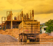 Trailer with building and worker sepia stock images