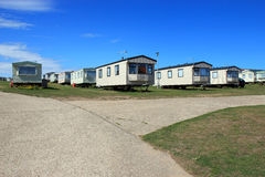 Trailer or caravan park. The entrance to a trailer or caravan park during the summer. Static holiday caravans, some are privately owned are some are owned by royalty free stock photos