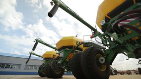 The trailer combines with the screw tubes are parked for agricultural machinery. On the territory of the agricultural complex, bottom view, medium shot stock video footage