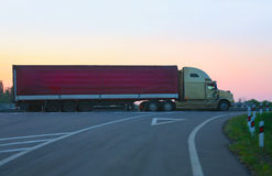 Trailer goes on  motorway against sunset Royalty Free Stock Photography