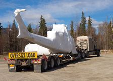 A trailer hauling a chopper in northern canada Stock Image