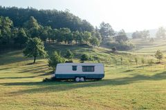 Trailer on side of mountain hill in grass royalty free stock photography