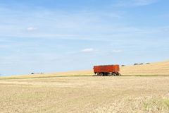 Trailer standing on a harvested field Royalty Free Stock Photography