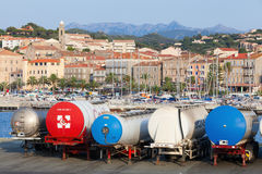 Trailer tanks stands in a row, Propriano port Royalty Free Stock Photos
