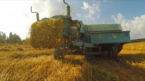 Trailer Of Tractor Making Bales Of Hay stock video