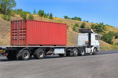 Trailer transports container on highway royalty free stock photo