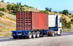 Trailer transports container on highway Stock Photography