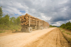 Trailer truck loaded with wooden logs Royalty Free Stock Image