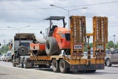 Trailer truck for move backhoe of PCN Asphalt Company. Stock Images