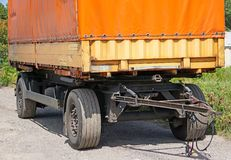 Trailer of a truck next to the road Royalty Free Stock Image