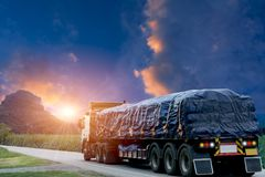 Trailer, trucks on an asphalt road in a rural for transportation. Concept stock photography