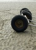 Trailer wheels on beach Royalty Free Stock Photography