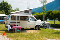 Trailers camping on Traunsee lake shore in Austrian Alps. Austria Royalty Free Stock Photos