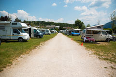 Trailers camping on Traunsee lake shore in Austrian Alps. Austria Stock Photos