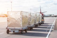 Trailers with containers of onboard aviation food for loading into a passenger airplane royalty free stock image